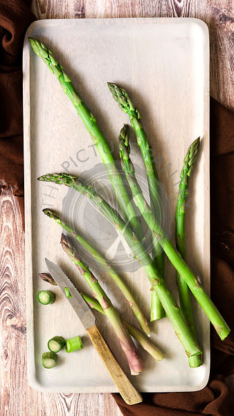 Asparagus spears trimmed with a knife.