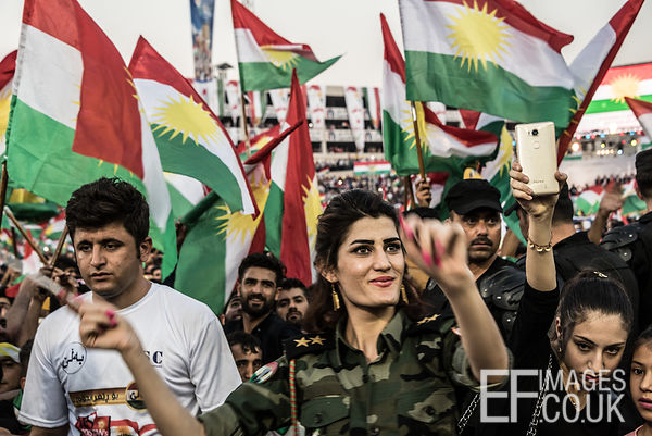 A woman dances amid waving flags at the final pro Kurdish independence rally, held at the Franso Hariri Stadium in Erbil. 22n...