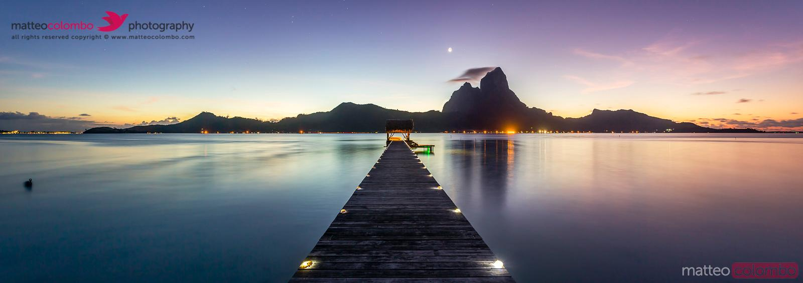 Panoramic of jetty at dusk,  Bora Bora, French Polynesia