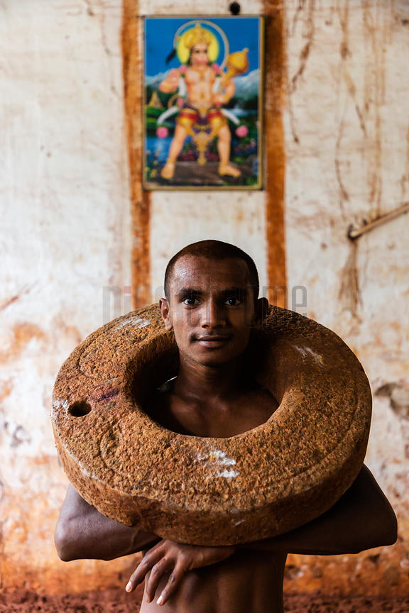 Kushti Wrestler Exercising with a gar Nal (Stone Neck Ring)