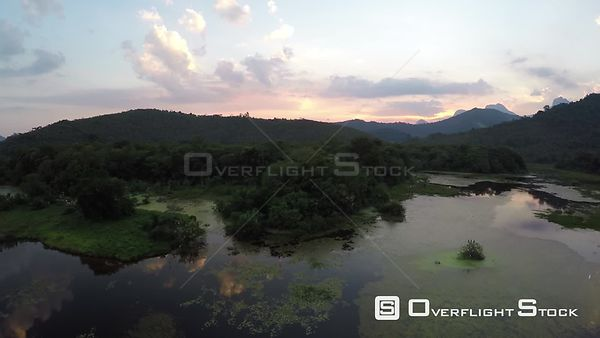 Aerial shot over an area of wetland in the Atlantic Forest, Reserva Ecologica de Guapiacu, Rio de Janeiro, Brazil, 2015.