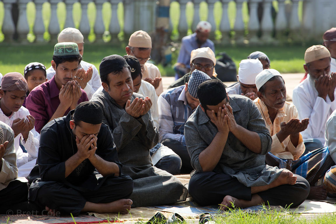 Muslim men pray during Eid al-Adha, Red Road, Madian, Kolkata, India. I have the only photos taken by a foreigner of this mos...