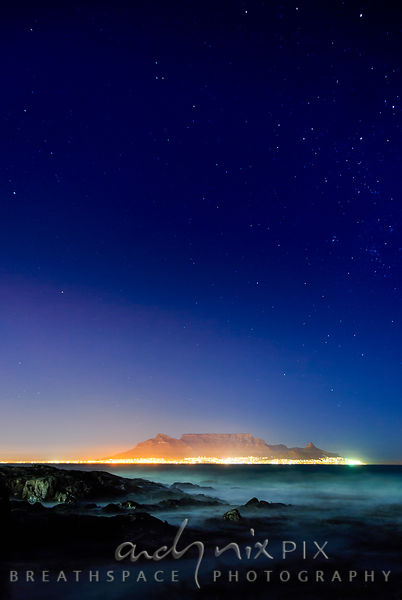 Night shot of stars above Table Mountain and Cape Town viewed from Blouberg.