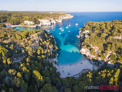 Aerial of bay at sunset, Cala Macarelleta, Menorca
