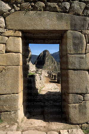 Huayna Picchu peak framed in main entrance doorway, Machu Picchu, Peru