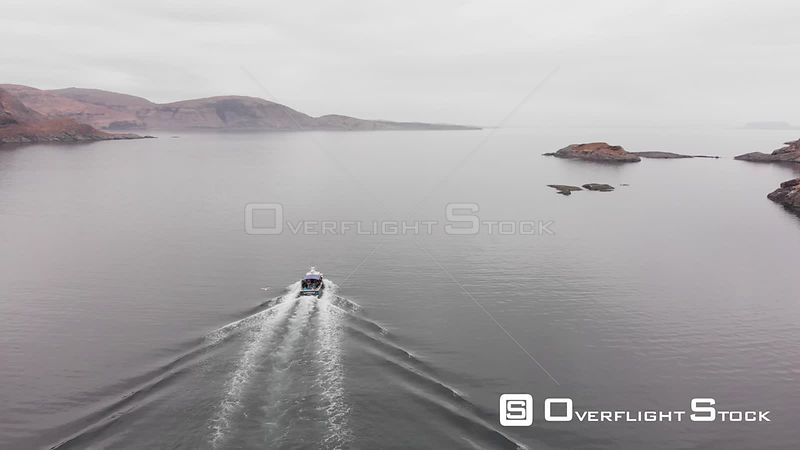 Aerial drone shot a boat taking tourists around Isle of Skye