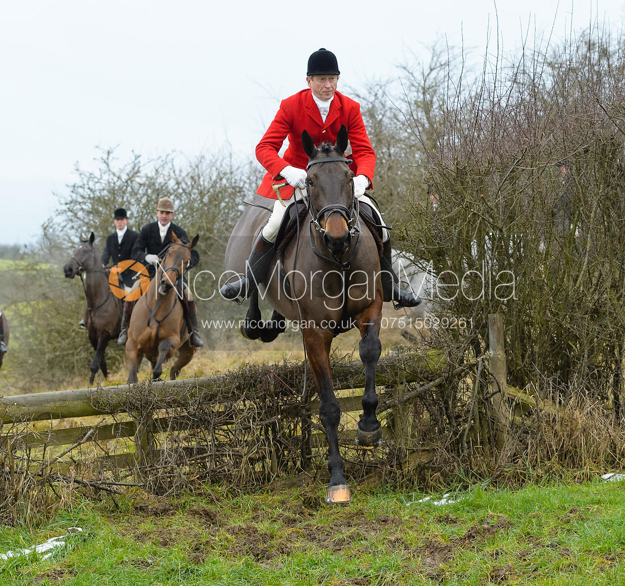 Nicholas Leeming jumping the hunt jump at Newbold - The Fitzwilliam Hunt visit the Cottesmore at Burrough House
