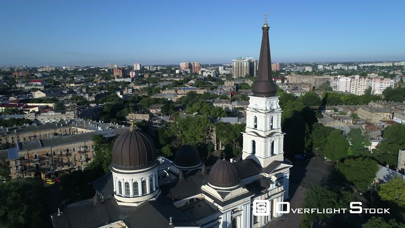 Drone camera flies slowly back from Preobrazhensky Cathedral on Saborna Square in Odessa Ukraine. Taken on a crystal clear su...