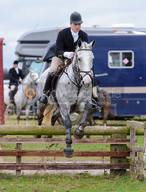 Angus Mossman jumping a hunt jump behind the kennels