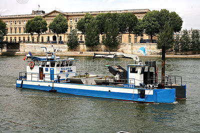 Boat Collecting Rubbish on The River Seine