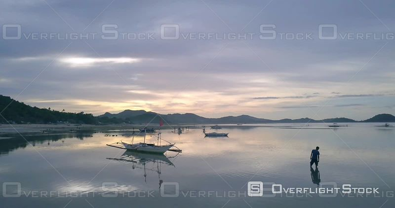 Men of Sicogon go fishing at sunset Drone Video Philippines