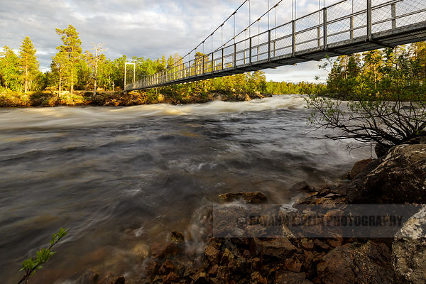 Bridge above the Jäniskoski rapids in Inari