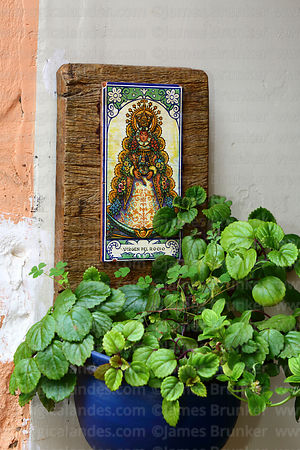 Ceramic tile with painting of Virgen del Rocío on wall of Tasca Madrid restaurant, Tarija, Bolivia