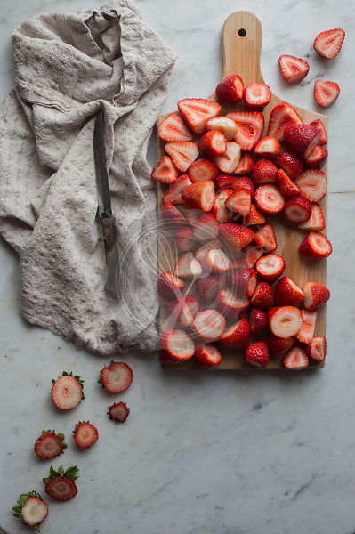 Strawberries on a chopping board