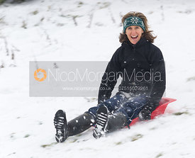 Zoe Gibson sledging on Burrough Hills, Leicestershire