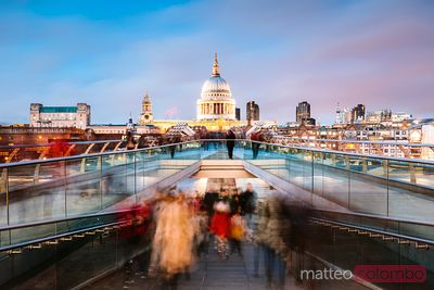 Millennium bridge and St Paul's cathedral with tourists, London