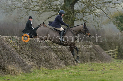 Phoebe Buckley jumping a hedge at Leicester Lane