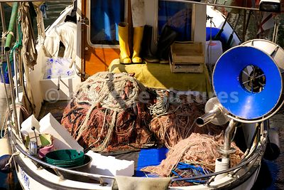 Small Fishing Boat Nets Stored on the Deck