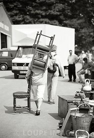 Woman carrying a chair