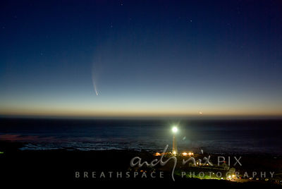 View over the sea of Comet McNaught with the Moon and Venus on the horizon, Slangkop Lighthouse in foreground