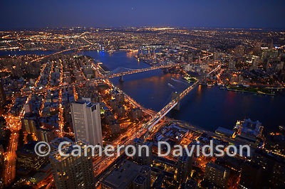 Aerial photograph of the East River, Brooklyn  and bridges crossing the East River.