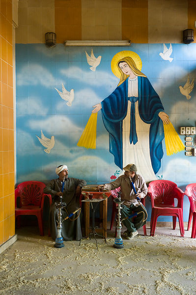 Egypt - Cairo - A man smokes a shisha pipe in the Qamar El Zaman coffeehouse in the Coptic Christian Zabbaleen area