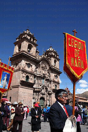Devotees of Legion de Maria parade past Compañia de Jesus church during Corpus Christi festival , Plaza de Armas , Cusco , Peru