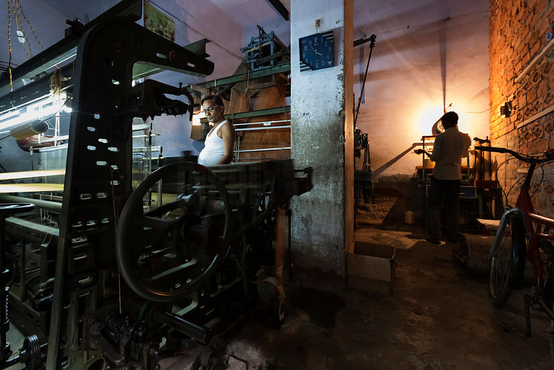 Men Working in a Silk Weaving Machine Shop