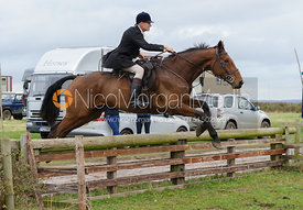John Knowles jumping a hunt jump behind the kennels