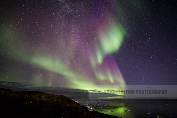 Northern Lights above the icebergs of the Ilulissat Icefjord