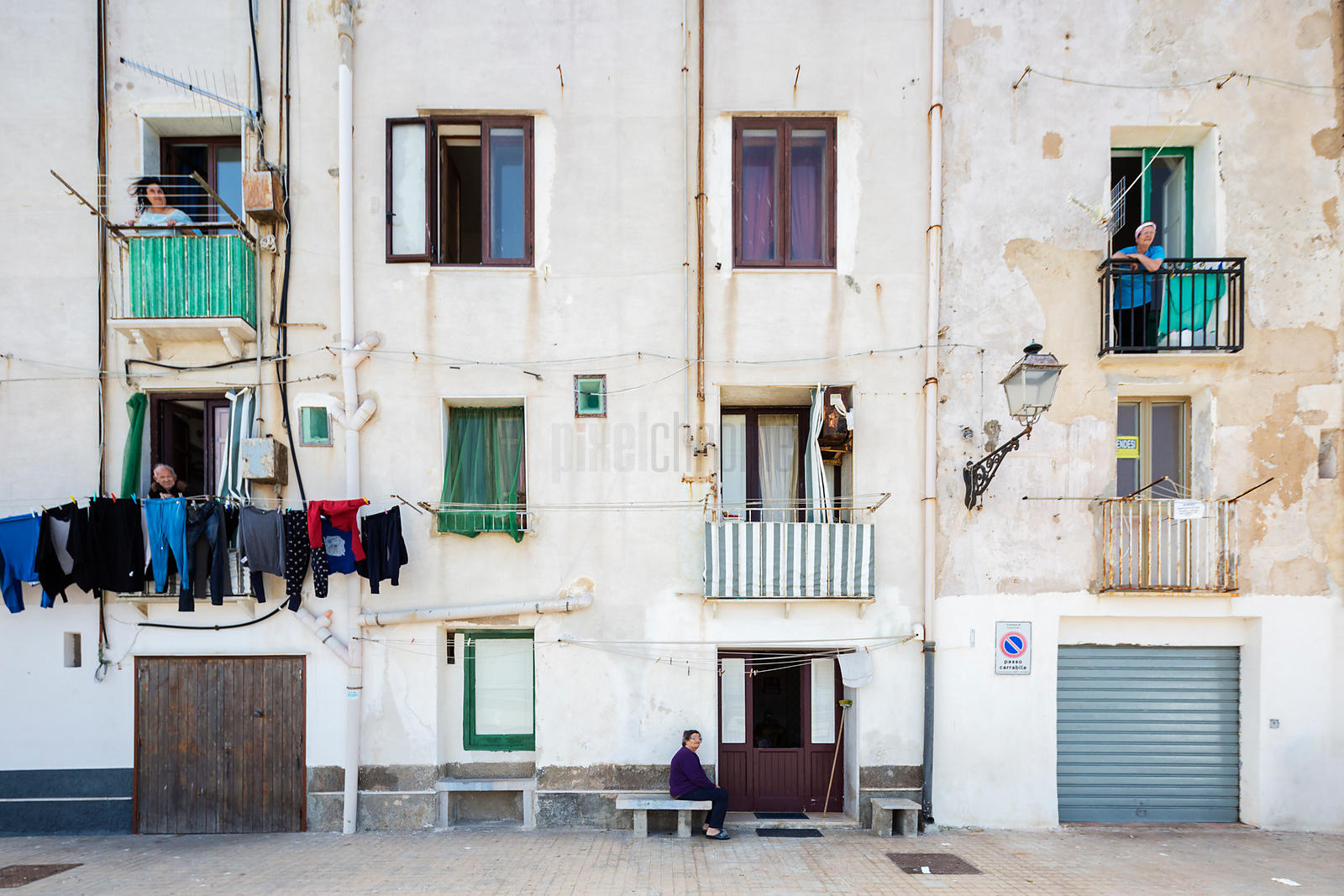 Locals Standing in the Balconies of their Homes