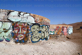 Graffiti / street art on water storage tanks at base of El Morro headland, Arica, Region XV, Chile