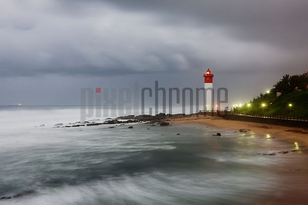 Umhlanga Rocks Lighthouse during a Storm at Dawn