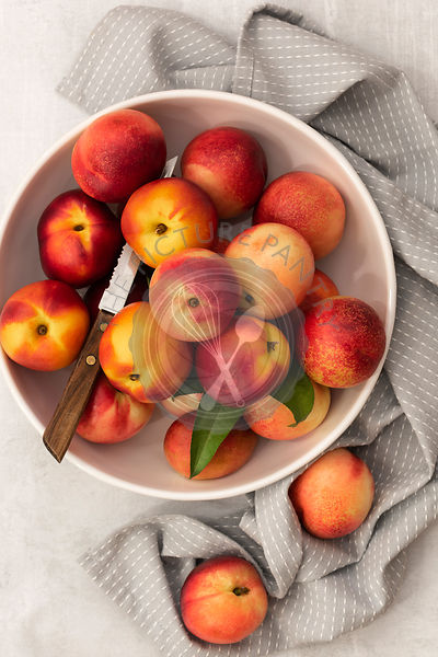 Fresh ripe nectarines in a bowl.