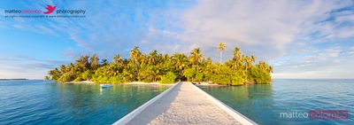 Panoramic of jetty leading to tropical island in the Maldives