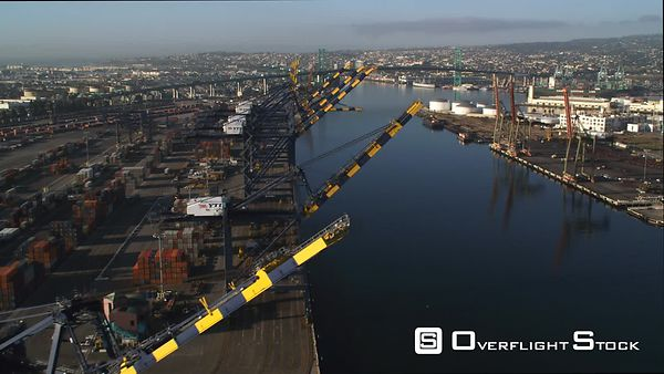 Loading Cranes at San Pedro Docks in Los Angeles Harbor, Vincent Thomas Bridge in Background.