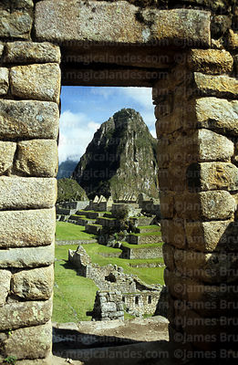 Huayna Picchu peak framed in Inca doorway, Machu Picchu, Peru