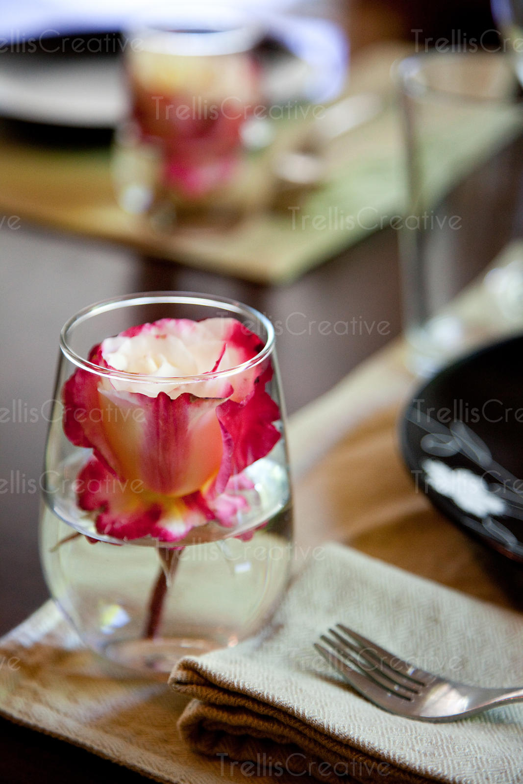 Rose in Glass at Table Setting