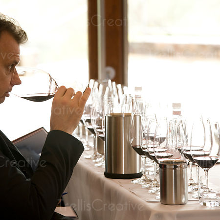 Smelling glass of red wine