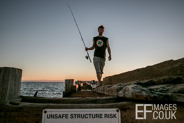 Fisherman On An Unsafe Structure