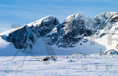 Snøhetta. From the left, the peaks are Vesttoppen (2,253 m), Hettpiggen (2,261 m), Midttoppen  (2,253 m). The highest, Storto...