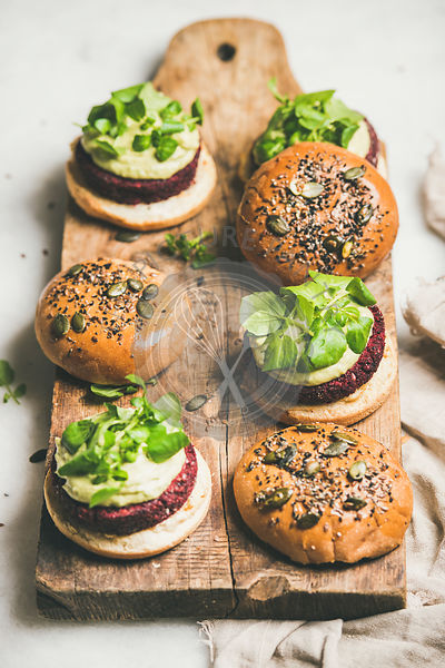 Healthy vegan burgers with beetroot patties and green sprouts