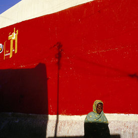 A woman walks beneath a hand painted advertisement, Hargeisa, Somaliland