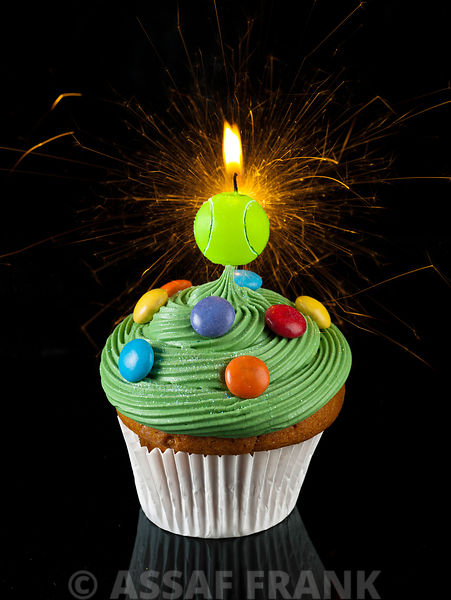 Cupcake with tennis ball shaped candle