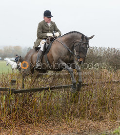 Johnny Arkwright jumping a hedge near Pasture Lane