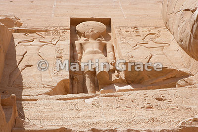 Statue of Re-Horakhete with a falcon head at the Sun Temple of Ramesses II, Abu Simbel, Egypt