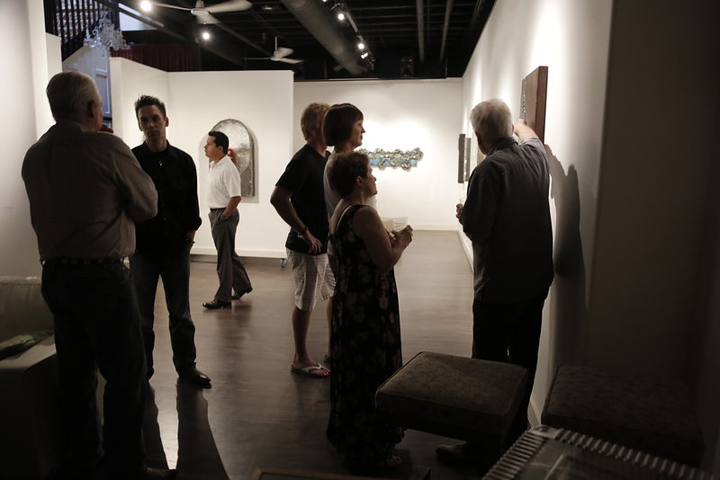 "Guests admired the current gallery show, ""A Recipe for Bliss,"" by Sue Latta"