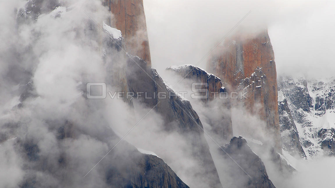 Trango towers in fog, the world's tallest cliffs, Baltoro Glacier, Baltistan, part of the Gilgit-Baltistan territory, norther...