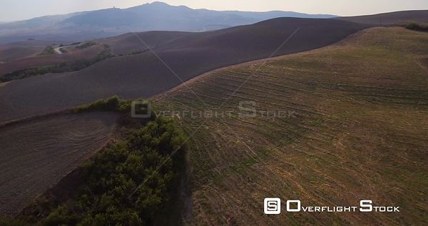 Aerial, gorgeous tuscan fields landscape near the city of Volterra