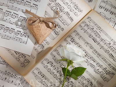 Heart and rose on musical notation book